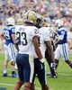 Sep 21, 2013; Durham, NC, USA; Pitt Panthers receiver Tyler Boyd (23) is congratulated by teammate Isaac Bennett (34) after a first half touchdown against the Duke Blue Devils at Wallace Wade Stadium. Mandatory Credit: Rob Kinnan-USA TODAY Sports