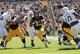 Sep 21, 2013; Iowa City, IA, USA; Iowa Hawkeyes running back Jordan Canzeri (33) splits the Western Michigan Broncos denfese during the second half at Kinnick Stadium. Iowa beat Western Michigan 59-3. Mandatory Credit: Reese Strickland-USA TODAY Sports