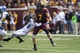 Sep 21, 2013; Minneapolis, MN, USA; Minnesota Golden Gophers quarterback Mitch Leidner (7) breaks away from a tackle by San Jose State Spartans safety Damon Ogburn (6) in the second half at TCF Bank Stadium. The Gophers won 43-24. Mandatory Credit: Jesse Johnson-USA TODAY Sports