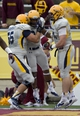 Sep 21, 2013; Mount Pleasant, MI, USA; Toledo Rockets running back Damion Jones-Moore (middle) celebrates with teammates offensive linesman Josh Hendershot (left) and tight end Zac Rosenbauer (right) during the fourth quarter against the Central Michigan Chippewas at Kelly/Shorts Stadium. Rockets beat the Chippewas 38-17. Mandatory Credit: Raj Mehta-USA TODAY Sports