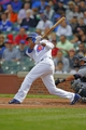Sep 21, 2013; Chicago, IL, USA; Chicago Cubs shortstop Starlin Castro (13) hits a single in the first inning against the Atlanta Braves at Wrigley Field. Mandatory Credit: Dennis Wierzbicki-USA TODAY Sports