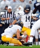 Sep 21, 2013; University Park, PA, USA; Kent State Golden Flashes kicker Anthony Melchiori (14) attempts a field goal in the first quarter against the Penn State Nittany Lions at Beaver Stadium. Mandatory Credit: Evan Habeeb-USA TODAY Sports