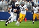 Sep 21, 2013; University Park, PA, USA; Penn State Nittany Lions tight end Kyle Carter (87) runs with the football in front of Kent State Golden Flashes linebacker Matt Dellinger (32) at Beaver Stadium. Mandatory Credit: Evan Habeeb-USA TODAY Sports