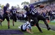 Sep 21, 2013; Evanston, IL, USA; Northwestern Wildcats linebacker Damien Proby (46) returns an interception for a touchdown past Maine Black Bears quarterback Marcus Wasilewski (7) during the second quarter at Ryan Field.  Mandatory Credit: Jerry Lai-USA TODAY Sports