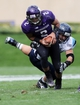 Sep 21, 2013; Evanston, IL, USA; Northwestern Wildcats quarterback Kain Colter (2) is tackled by Maine Black Bears linebacker Zachary Hume (44) during the first quarter at Ryan Field.  Mandatory Credit: Jerry Lai-USA TODAY Sports