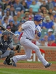 Sep 21, 2013; Chicago, IL, USA; Chicago Cubs center fielder Ryan Sweeney (6) hits a single in the fifth inning against the Atlanta Braves at Wrigley Field. Mandatory Credit: Dennis Wierzbicki-USA TODAY Sports