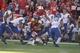 Sep 21, 2013; Lincoln, NE, USA; South Dakota State Jackrabbits defender R.C. Kilgore (42) tackles Nebraska Cornhuskers running back Ameer Abdullah (8) in the third quarter at Memorial Stadium. Mandatory Credit: Bruce Thorson-USA TODAY Sports
