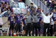 Sep 21, 2013; Evanston, IL, USA; Northwestern Wildcats coaches call an offensive play as quarterback Matt Alviti (7) holds up a coded play chart during the third quarter against the Maine Black Bears at Ryan Field.  Mandatory Credit: Jerry Lai-USA TODAY Sports