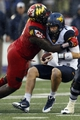 Sep 21, 2013; Baltimore, MD, USA; West Virginia Mountaineers quarterback Ford Childress (7) is sacked by Maryland Terrapins Darius Kilgo lineman (97) at M&T Bank Stadium. Mandatory Credit: Mitch Stringer-USA TODAY Sports