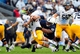 Sep 21, 2013; University Park, PA, USA; Kent State Golden Flashes quarterback David Fisher (7) gets tackled by Penn State Nittany Lions defensive tackle DaQuan Jones (91) at Beaver Stadium. Mandatory Credit: Evan Habeeb-USA TODAY Sports