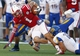 Sep 21, 2013; Lincoln, NE, USA; South Dakota State Jackrabbits defender Austin Knowlton (16) tackles Nebraska Cornhuskers Jordan Westerkamp (1) in the fourth quarter at Memorial Stadium. Nebraska won 59-20. Mandatory Credit: Bruce Thorson-USA TODAY Sports