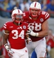 Sep 21, 2013; Lincoln, NE, USA; Nebraska Cornhuskers running back Terrell Newby celebrates his touchdown with Jake Cotton against the South Dakota State Jackrabbits in the fourth quarter at Memorial Stadium. Nebraska won 59-20. Mandatory Credit: Bruce Thorson-USA TODAY Sports