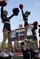 Sep 21, 2013; Oxford, OH, USA; Cincinnati Bearcats cheerleaders cheer during a game against the Miami (Oh) Redhawks at Fred Yager Stadium. Mandatory Credit: David Kohl-USA TODAY Sports