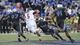 Sep 21, 2013; Memphis, TN, USA; Arkansas State Red Wolves quarterback Adam Kennedy (5) scrambles against the Memphis Tigers at Liberty Bowl Memorial. Mandatory Credit: Justin Ford-USA TODAY Sports