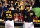 Sep 21, 2013; Pittsburgh, PA, USA; Pittsburgh Pirates catcher Russell Martin (55) is greeted at home by third baseman Pedro Alvarez (24) after Martin hit a two run home run against the Cincinnati Reds during the second inning at PNC Park. Mandatory Credit: Charles LeClaire-USA TODAY Sports