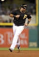 Sep 21, 2013; Pittsburgh, PA, USA; Pittsburgh Pirates third baseman Pedro Alvarez (24) rounds the bases to score on a two run home run by catcher Russell Martin (not pictured) against the Cincinnati Reds during the second inning at PNC Park. Mandatory Credit: Charles LeClaire-USA TODAY Sports