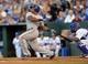Sep 21, 2013; Kansas City, MO, USA; Texas Rangers third basemen Adrian Beltre (29) drives in a run against the Kansas City Royals during the third inning at Kauffman Stadium. Mandatory Credit: Peter G. Aiken-USA TODAY Sports