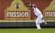 Sep 21, 2013; Kansas City, MO, USA; Kansas City Royals left fielder Alex Gordon (4) runs down a fly ball against the Texas Rangers during the fifth inning at Kauffman Stadium. Mandatory Credit: Peter G. Aiken-USA TODAY Sports