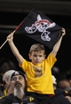 Sep 21, 2013; Pittsburgh, PA, USA; A young Pittsburgh Pirates fan displays the jolly roger flag against the Cincinnati Reds during the eighth inning at PNC Park. The Pittsburgh Pirates won 4-2. Mandatory Credit: Charles LeClaire-USA TODAY Sports