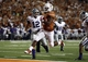 Sep 21, 2013; Austin, TX, USA; Texas Longhorns running back Johnathan Gray (32) rushes past Kansas State Wildcats defensive back Ty Zimmerman (12) on his way for a touchdown during the third quarter of a football game at Darrell K Royal-Texas Memorial Stadium. Mandatory Credit: Jim Cowsert-USA TODAY Sports
