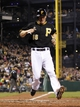 Sep 21, 2013; Pittsburgh, PA, USA; Pittsburgh Pirates first baseman Justin Morneau (66) scores a run against the Cincinnati Reds during the sixth inning at PNC Park. The Pittsburgh Pirates won 4-2. Mandatory Credit: Charles LeClaire-USA TODAY Sports