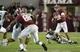 Sep 21, 2013; Tuscaloosa, AL, USA;  Alabama Crimson Tide quarterback A.J. McCarron (10) rolls out to pass against the Colorado State Rams at Bryant-Denny Stadium. Alabama defeated Colorado State 31-6. Mandatory Credit: John David Mercer-USA TODAY Sports