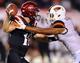 Sep 21, 2013; San Diego, CA, USA; San Diego State Aztecs quarterback Quinn Kaehler (18) is sacked by Oregon State Beavers linebacker D.J. Alexander (4) during the second half at Qualcomm Stadium. Mandatory Credit: Christopher Hanewinckel-USA TODAY Sports