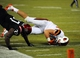 Sep 21, 2013; San Diego, CA, USA; Oregon State Beavers tight end Connor Hamlett (89) rolls over after being tackled by San Diego State Aztecs linebacker Vaness Harris (37) during the second half at Qualcomm Stadium. Mandatory Credit: Christopher Hanewinckel-USA TODAY Sports