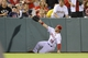 Sep 21, 2013; Anaheim, CA, USA; Los Angeles Angels left fielder Collin Cowgill (19) slides for a fly ball against the Seattle Mariners during the eighth inning at Angel Stadium of Anaheim. Mandatory Credit: Kelvin Kuo-USA TODAY Sports