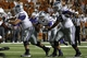 Sep 21, 2013; Austin, TX, USA; Kansas State Wildcats quarterback Jake Waters (15) fumbles against the Texas Longhorns during the fourth quarter of a football game at Darrell K Royal-Texas Memorial Stadium. The Longhorns won 31-21. Mandatory Credit: Jim Cowsert-USA TODAY Sports