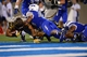 Sep 21, 2013; Colorado Springs, CO, USA;Wyoming Cowboys running back Shaun Wick (21) scores on a three yard touchdown run as Air Force Falcons defensive lineman Ryan Watson (40) defends in the third quarter at Falcon Stadium. Mandatory Credit: Ron Chenoy-USA TODAY Sports