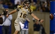 Sep 21, 2013; Colorado Springs, CO, USA; Wyoming Cowboys quarterback Brett Smith (16) reacts to his six yard touchdown run against the Air Force Falcons in the second quarter at Falcon Stadium. The Cowboys defeated the Falcons 56-23. Mandatory Credit: Ron Chenoy-USA TODAY Sports