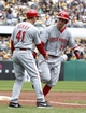 Sep 22, 2013; Pittsburgh, PA, USA; Cincinnati Reds third base coach Mark Berry (41) greets third baseman Todd Frazier (21) after Frazier hit a two run home run against the Pittsburgh Pirates during the first inning at PNC Park. Mandatory Credit: Charles LeClaire-USA TODAY Sports