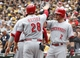 Sep 22, 2013; Pittsburgh, PA, USA; Cincinnati Reds left fielder Chris Heisey (28) is greeted by shortstop Zack Cozart (2) after scoring a run against the Pittsburgh Pirates during the first inning at PNC Park. Mandatory Credit: Charles LeClaire-USA TODAY Sports
