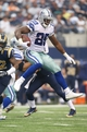 Sep 22, 2013; Arlington, TX, USA; Dallas Cowboys running back DeMarco Murray (29) leaps as he runs with the ball in the third quarter against the St. Louis Rams at AT&T Stadium. The Dallas Cowboys beat St. Louis Rams 31-7. Mandatory Credit: Matthew Emmons-USA TODAY Sports