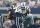 Sep 22, 2013; Arlington, TX, USA; Dallas Cowboys defensive tackle Jason Hatcher (97) tackles St. Louis Rams running back Isaiah Pead (24) in the third quarter at AT&T Stadium. Mandatory Credit: Matthew Emmons-USA TODAY Sports