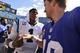 Sep 22, 2013; Charlotte, NC, USA; Carolina Panthers quarterback Cam Newton (1) with New York Giants quarterback Eli Manning (10) after the game. The Carolina Panthers defeated the New York Giants 38-0 at Bank of America Stadium. Mandatory Credit: Bob Donnan-USA TODAY Sports