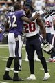 Sep 22, 2013; Baltimore, MD, USA; Houston Texans safety Ed Reed (20) greets former Baltimore Ravens teammate and wide receiver Torrey Smith (82) during the game at M&T Bank Stadium. Mandatory Credit: Mitch Stringer-USA TODAY Sports
