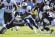 Sep 22, 2013; Nashville, TN, USA; Tennessee Titans wide receiver Kendall Wright (13) carries the ball after a reception against San Diego Chargers cornerback Rihcard Marshall (31) during the second half at LP Field. The Titans beat the Chargers 20-17. Mandatory Credit: Don McPeak-USA TODAY Sports