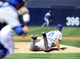 Sep 22, 2013; San Diego, CA, USA; Los Angeles Dodgers starting pitcher Zack Greinke (21) is unable to field a ground ball during the first inning against the San Diego Padres at Petco Park. Mandatory Credit: Christopher Hanewinckel-USA TODAY Sports