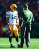 Sep 22, 2013; Cincinnati, OH, USA; Green Bay Packers quarterback Aaron Rodgers (12) talks with head coach Mike McCarthy during the fourth quarter against the Cincinnati Bengals at Paul Brown Stadium. Mandatory Credit: Andrew Weber-USA TODAY Sports
