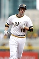 Sep 22, 2013; Pittsburgh, PA, USA; Pittsburgh Pirates second baseman Neil Walker (18) rounds the bases after hitting a solo home run against the Cincinnati Reds during the third inning at PNC Park. The Reds won 11-3. Mandatory Credit: Charles LeClaire-USA TODAY Sports