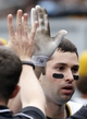 Sep 22, 2013; Pittsburgh, PA, USA; Pittsburgh Pirates second baseman Neil Walker (18) is greeted in the dugout after hitting a solo home run against the Cincinnati Reds during the third inning at PNC Park. The Reds won 11-3. Mandatory Credit: Charles LeClaire-USA TODAY Sports