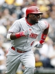 Sep 22, 2013; Pittsburgh, PA, USA; Cincinnati Reds second baseman Brandon Phillips (4) runs to first after hitting a single against the Pittsburgh Pirates during the fourth inning at PNC Park. The Reds won 11-3. Mandatory Credit: Charles LeClaire-USA TODAY Sports