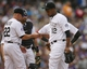 Sep 22, 2013; Denver, CO, USA; Colorado Rockies starting pitcher Juan Nicasio (12) is taken out of the game by manager Walt Weiss (22) during the third inning against the Arizona Diamondbacks at Coors Field. Mandatory Credit: Chris Humphreys-USA TODAY Sports