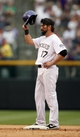 Sep 22, 2013; Denver, CO, USA; Colorado Rockies first baseman Todd Helton (17) acknowledges the crowd's applause after hitting his 1400th career RBI during the fifth inning against the Arizona Diamondbacks at Coors Field. Mandatory Credit: Chris Humphreys-USA TODAY Sports