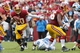 Sep 22, 2013; Landover, MD, USA; Washington Redskins quarterback Robert Griffin III (10) runs with the ball past Detroit Lions defensive tackle Nick Fairley (98) in the fourth quarter at FedEx Field. The Lions won 27-20. Mandatory Credit: Geoff Burke-USA TODAY Sports
