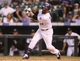 Sep 22, 2013; Denver, CO, USA; Colorado Rockies first baseman Todd Helton (17) hits an RBI single during the ninth inning against the Arizona Diamondbacks at Coors Field. The Diamondbacks won 13-9.  Mandatory Credit: Chris Humphreys-USA TODAY Sports