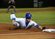 Sep 23, 2013; Chicago, IL, USA; Chicago Cubs left fielder Brian Bogusevic (47) slides safely into third base against the Pittsburgh Pirates during the eighth inning at Wrigley Field. Mandatory Credit: David Banks-USA TODAY Sports