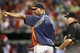 Sep 23, 2013; Arlington, TX, USA; Houston Astros manager Bo Porter (16) talks to umpire Jerry Meals (41) during the sixth inning of a baseball game against the Texas Rangers at Rangers Ballpark in Arlington. Mandatory Credit: Jim Cowsert-USA TODAY Sports